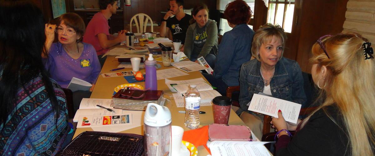 Evangelism Training attendees practicing sharing the Gospel